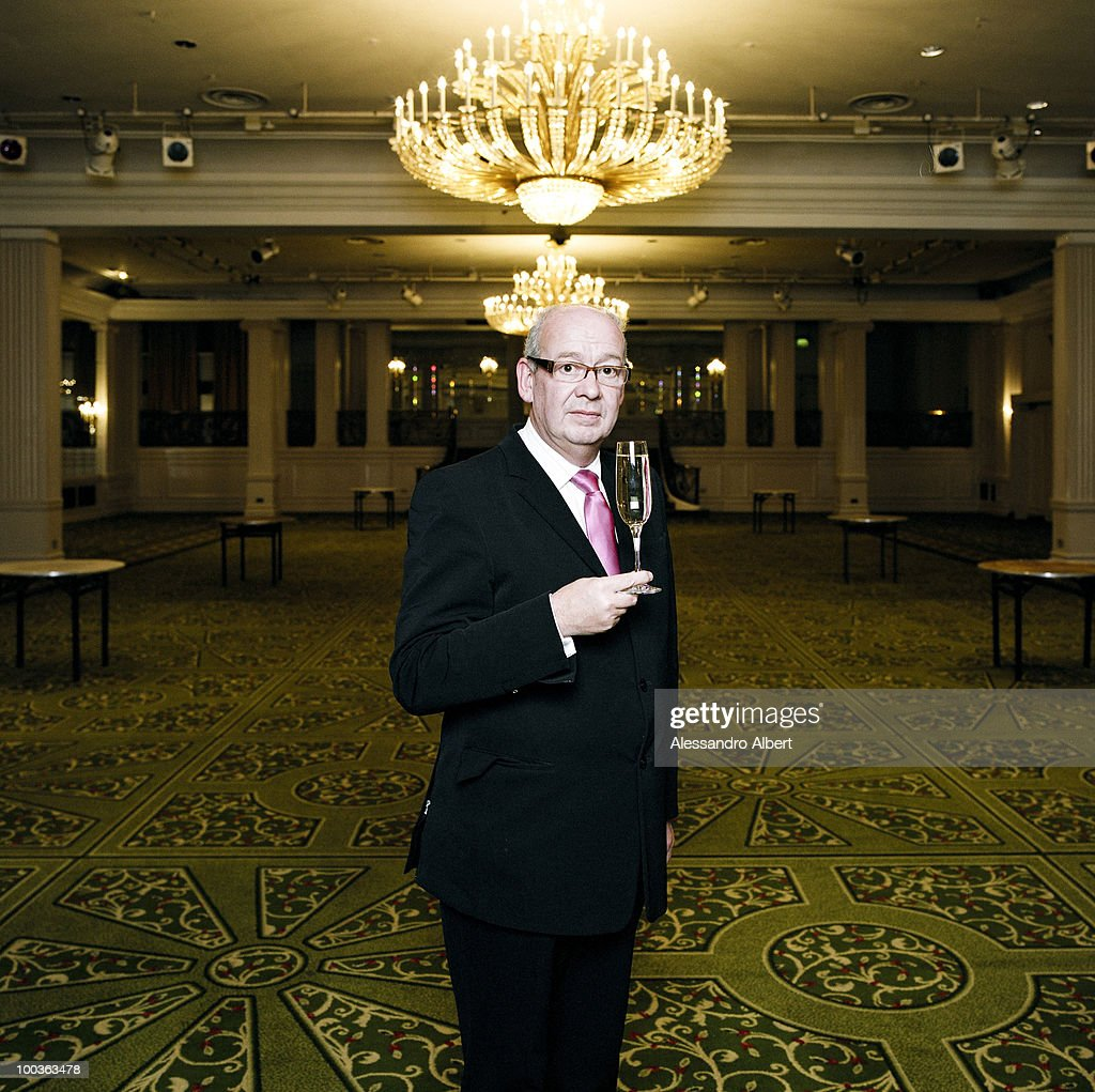 The wedding planner Andrew Wright of the agency Fab poses for a portraits session in the dance hall of Grasnover Park Lane Hotel on December 12, 2007 in London, England