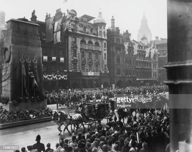 The wedding procession of Princess Elizabeth and Lieutenant Philip Mountbatten passes the Cenotaph on its way back to Buckingham Palace after the...