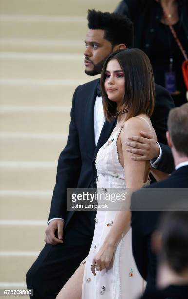 The Weekend and Selena Gomez attend 'Rei Kawakubo/Comme des Garcons Art Of The InBetween' Costume Institute Gala at Metropolitan Museum of Art on May...