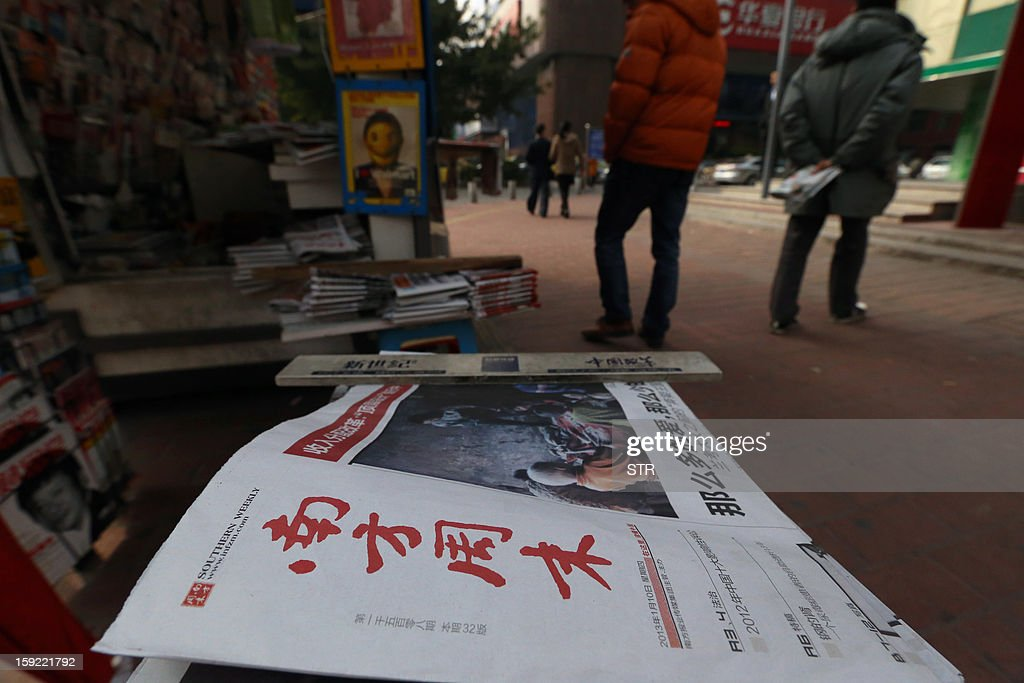 The weekly Nanfang Zhoumo newspaper (C) is displayed at a newstand in Guangzhou on January 10, 2013. The row at the popular liberal paper, which had an article urging greater rights protection replaced with one praising the ruling communist party, has seen demonstrators mass outside its headquarters in the southern city of Guangzhou.