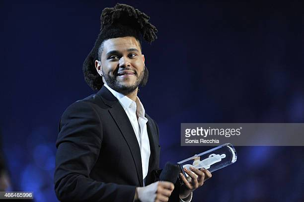 The Weeknd is presented an award at the 2015 JUNO Awards at FirstOntario Centre on March 15 2015 in Hamilton Canada
