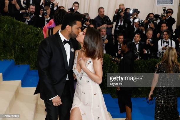The Weeknd kisses Selena Gomez at 'Rei Kawakubo/Commes Des Garcons Art of the InBetween' the 2017 Costume Institute Benefit at Metropolitan Museum of...