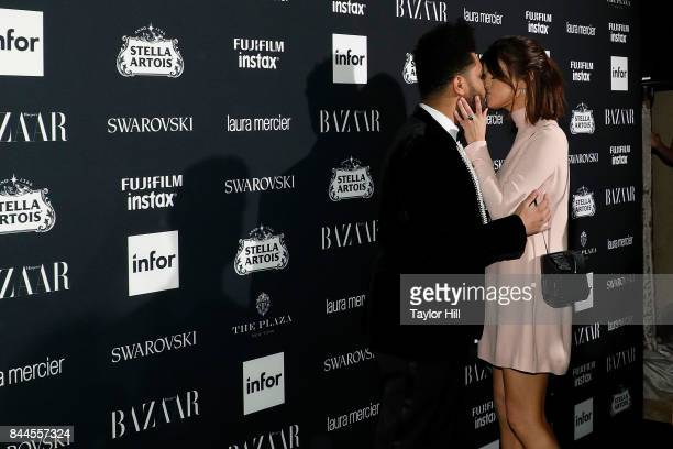 The Weeknd kisses Selena Gomez during the 2017 Harper ICONS Party at The Plaza Hotel on September 8 2017 in New York City