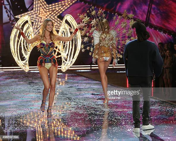 The Weeknd performs as Martha Hunt and Constance Jablonski walk the runway at the 2015 Victoria's Secret Fashion Show at Lexington Avenue Armory on...