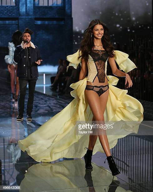 The Weeknd performs as model Bruna Lirio walks the runway during the 2015 Victoria's Secret Fashion Show at Lexington Avenue Armory on November 10...