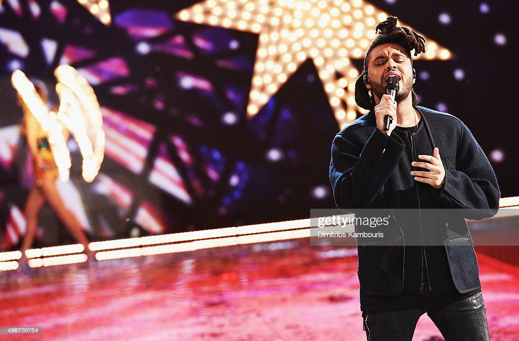 <a gi-track='captionPersonalityLinkClicked' href=/galleries/search?phrase=The+Weeknd+-+Musician&family=editorial&specificpeople=8008743 ng-click='$event.stopPropagation()'>The Weeknd</a> performs onstage on the runway during the 2015 Victoria's Secret Fashion Show at Lexington Avenue Armory on November 10, 2015 in New York City.