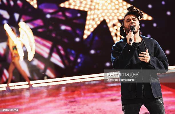 The Weeknd performs onstage on the runway during the 2015 Victoria's Secret Fashion Show at Lexington Avenue Armory on November 10 2015 in New York...