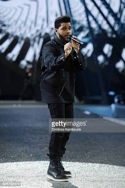 The Weeknd sings on the runway during the 2016 Victoria's Secret Fashion Show on November 30 2016 in Paris France