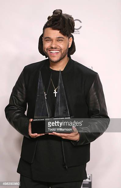 The Weeknd winner of the Favorite Male Artist award Soul/RnB and Favorite Album award Soul/Rnb poses in the press room during the 2015 American Music...