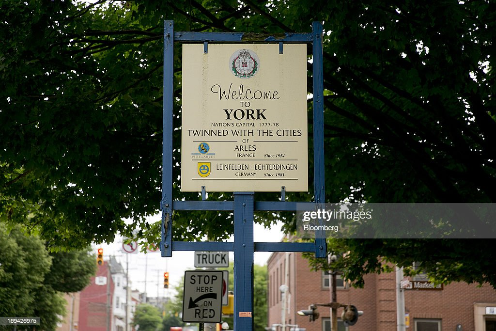 The welcome sign for York, Pennsylvania, U.S., stands in the city on Thursday, May 23, 2013. BAE Systems Plc, which has a manufacturing facility in York, is deploying smaller suppliers to pressure U.S. lawmakers to speed up orders to modernize Bradley fighting vehicles, a move the company said may protect thousands of subcontractor jobs and keep a Pennsylvania assembly line open. Photographer: Andrew Harrer/Bloomberg via Getty Images