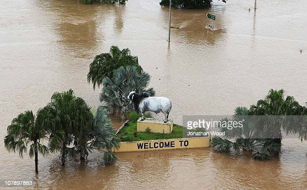 The welcome sign on the outskirts of the city is surrounded by flood waters on January 6 2011 in Rockhampton Australia All eyes are on the central...