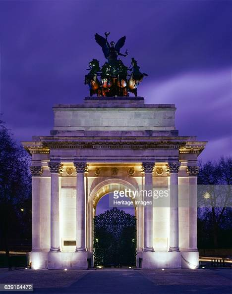 The Wellington Arch Hyde Park Corner London c19902010 View of the floodlit arch Wellington Arch is a triumphal arch located to the south of Hyde Park...