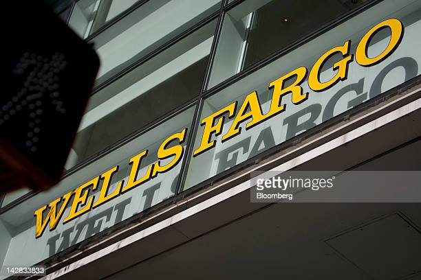 The Wells Fargo Co logo is displayed atop a bank branch in New York US on Friday April 13 2012 Wells Fargo Co the largest US home lender reported a...