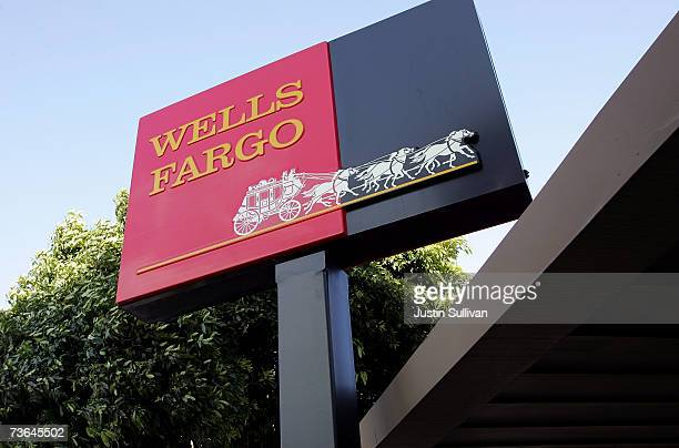 The Wells Fargo logo is seen on a sign outside of a Wells Fargo Home Mortgage branch office March 20 2007 in San Francisco California San Francisco...