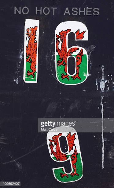 The Welsh flag on numbers are stuck to a wheelie bin outside a row of terraced houses on March 1 2011 in Blaenavon Wales Blaenavon's industrial...