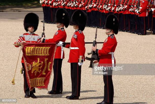 The Welsh Guards Colour is unsheathed before the start of the Trooping the Colour Ceremony on Horse Guards parade ground in Central London More than...