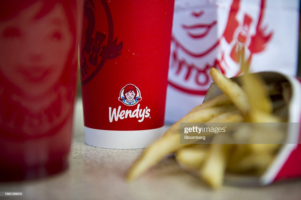 The Wendy's Co. logo is seen on a cup displayed for a photograph at a restaurant location in Daly City, California, U.S., on Tuesday, May 7, 2013. Wendy's Co. is expected to release earnings data on May 8. Photographer: David Paul Morris/Bloomberg via Getty Images