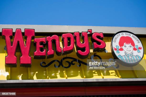 The Wendy's sign is seen outside their restaurant in Bowie Maryland on May 9 2017 An American teenager has broken the world record for the most...