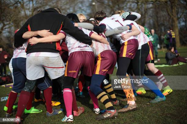 The Werewolves of London quidditch team huddle during the Crumpet Cup quidditch tournament on Clapham Common on February 18 2017 in London England...