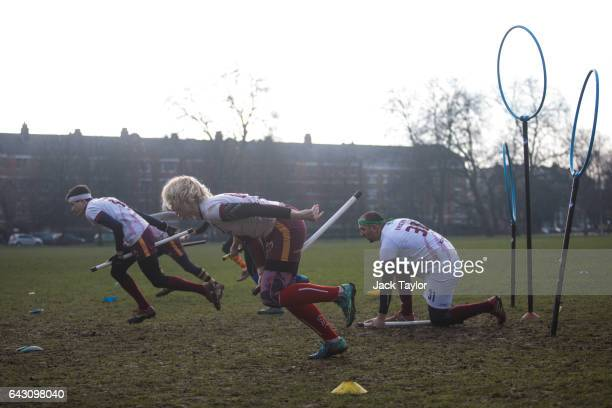 The Werewolves of London quidditch team run during the Crumpet Cup quidditch tournament on Clapham Common on February 18 2017 in London England...