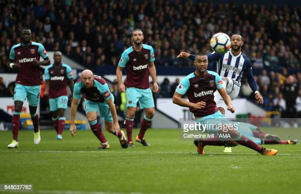 The West Ham team watch as Matt Phillips of West Bromwich Albion takes a shot during the Premier League match between West Bromwich Albion and West...