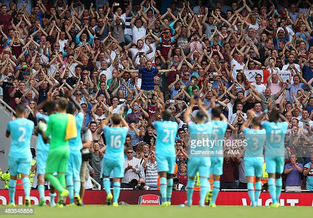 The West Ham United team celebrate with their fans after the Barclays Premier League match between Arsenal and West Ham United at Emirates Stadium on...