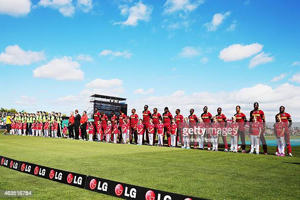 The West Indies and Ireland sing the national anthems prior to the 2015 ICC Cricket World Cup match between the West Indies and Ireland at Saxton...