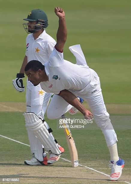 The West Indies' bowler Shannon Gabriel delivers the ball next to Pakistani batsman Mohammad Nawaz on the second day of the second Test between...
