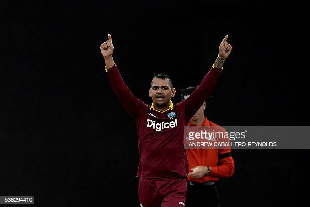 The West Indie's bowler Sunil Narine celebrates dismissing Australia's Captain Steven Smith during a Oneday International cricket match between the...