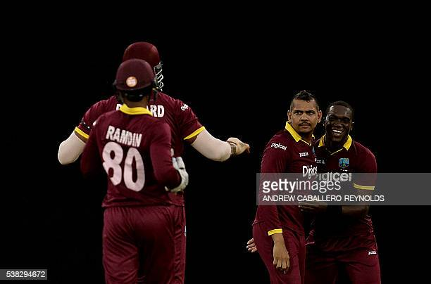The West Indie's bowler Sunil Narine celebrates dismissing Australia's Glenn Maxwell during a Oneday International cricket match between the West...