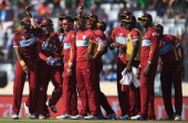 The West Indies players celebrate the wicket of Shane Watson of Australia after he was stumped by Denesh Ramdin during the ICC World Twenty20...
