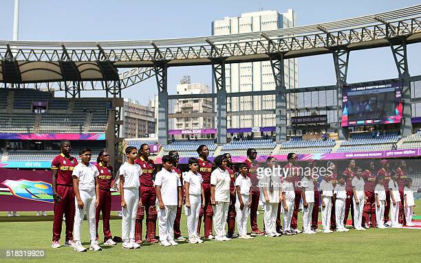 The West Indies players sing their national anthem during the Women's ICC World Twenty20 India 2016 Semi Final match between New Zealand and West...
