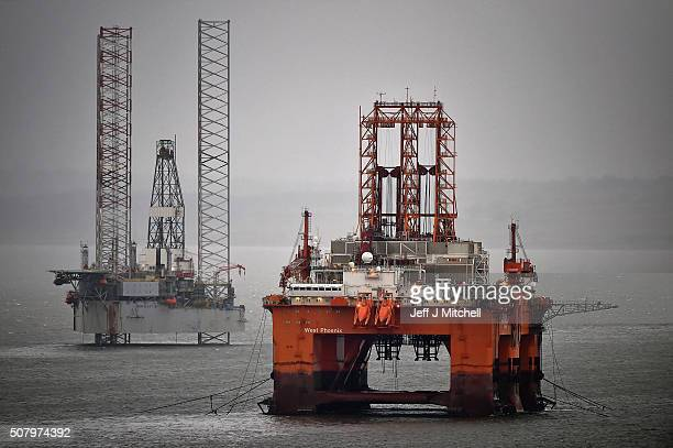 The West Phoenix rig stands amongst other rigs which have been left in the Cromarty Firth on February 2 2016 in Invergordon Scotland Rig platforms...