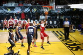 The West Team shoots against the East Team during the NBA Cares Special Olympics Unified Sports Basketball Game at Sprint Arena during the 2014 NBA...