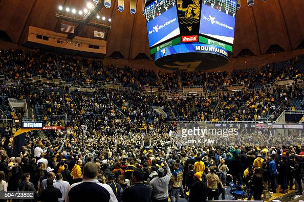 The West Virginia Mountaineers celebrate with students after upsetting the Kansas Jayhawks 7463 at the WVU Coliseum on January 12 2016 in Morgantown...