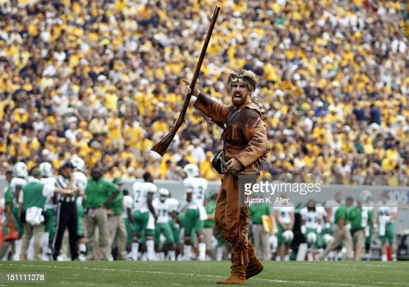 The West Virginia Mountaineers mascot pumps up the crowd during the game against the Marshall Thundering Herd on September 1 2012 at Mountaineer...