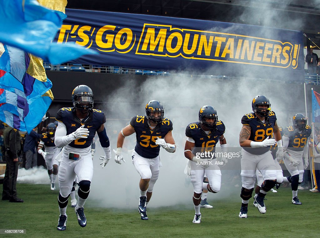 The West Virginia Mountaineers run onto the field before the game against the Baylor Bears on October 18 2014 at Mountaineer Field in Morgantown West...