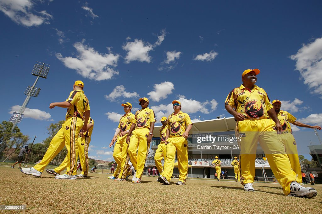 The Western Australian team walk onto the ground for their first match during the National Indigenous Cricket Championships on February 8, 2016 in Alice Springs, Australia.