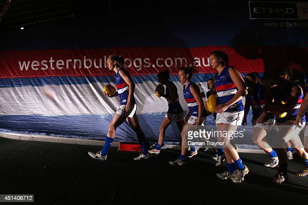 The Western Bulldogs players walk out onto the ground before the women's exhibition AFL match between the Western Bulldogs and the Melbourne Demons...