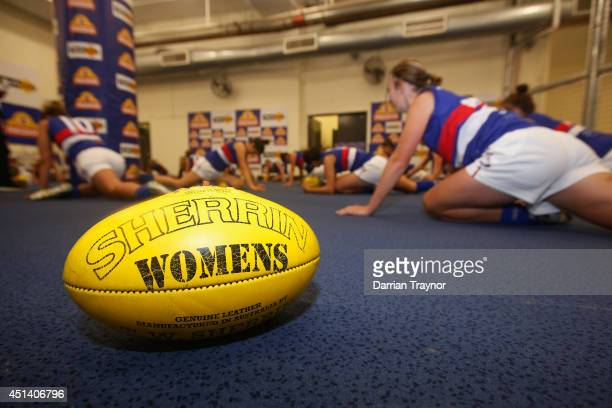 The Western Bulldogs players warm up before the women's exhibition AFL match between the Western Bulldogs and the Melbourne Demons at Etihad Stadium...