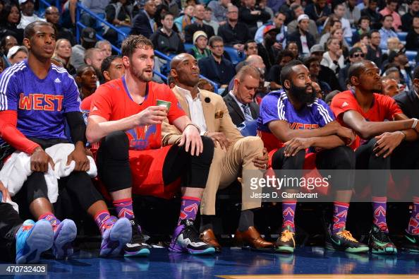 The Western Conference bench Chris Paul Kevin Love Kobe Bryant James Harden and Kevin Durant during the game against the Eastern Conference at the...