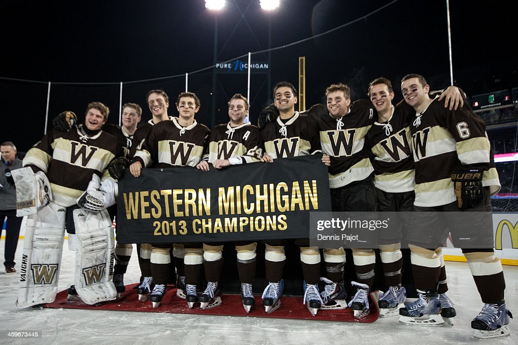 The Western Michigan Broncos celebrate a 1-0 overtime win in the GLI championship game over the Michigan Tech Huskies on December 28, 2013 at Comerica Park in Detroit, Michigan.