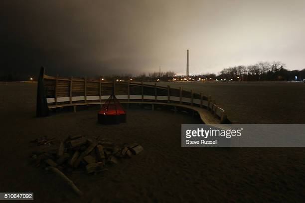 The Western most installation features a fire pit along with a curved bench space for seating in the Winter Stations art project Winter Stations is...