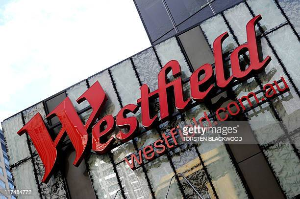 The Westfield corporate logo adorns the glass cladding of its new headquarters in Sydney on June 27 2011 Australia's largest shopping centre builder...