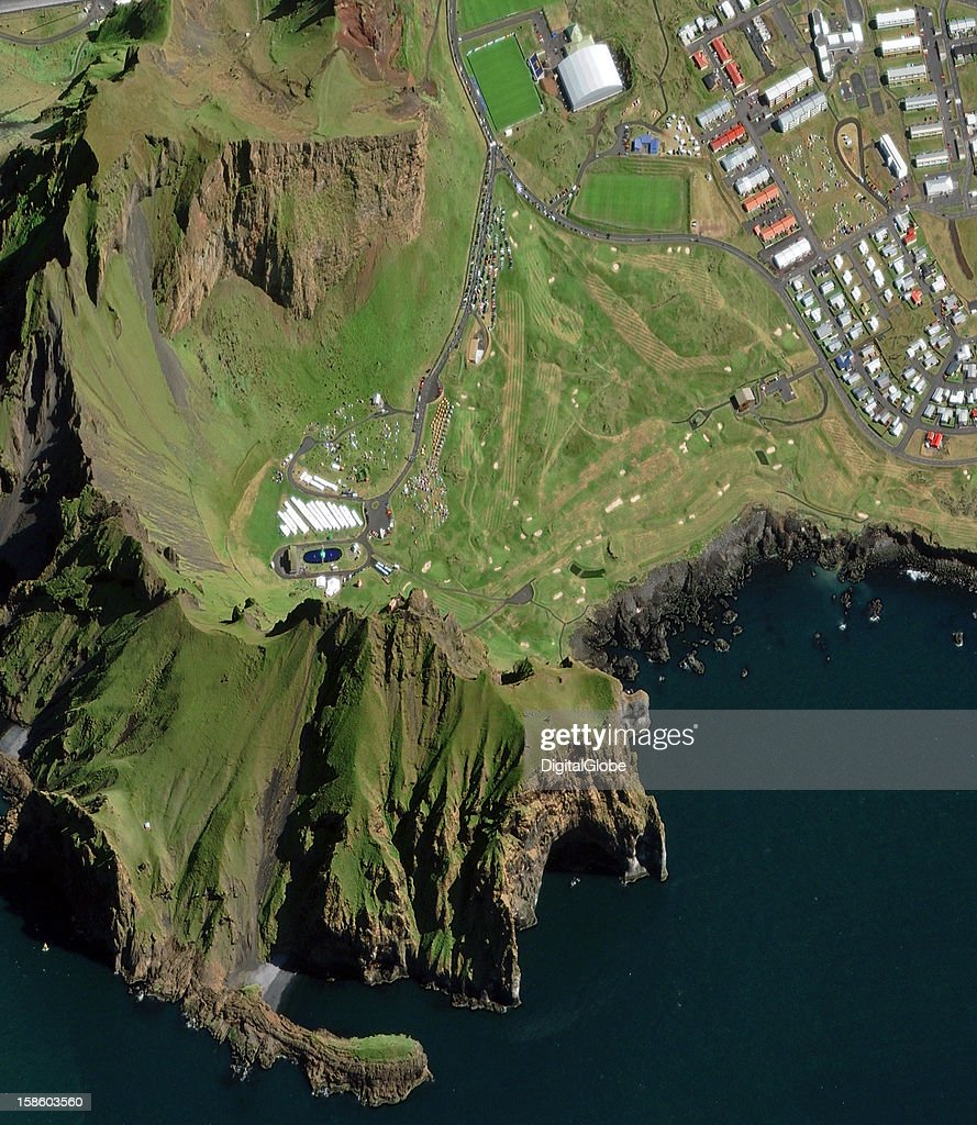 The Westman Islands Festival is held annually on the first weekend of August near the town of Vestmannaeyjar on the southern Icelandic island of Heimaey. The first festival was held in 1874, the year Iceland celebrated 1,000 years of settlement and the ratification of Iceland's Constitution. On this image you can see the festival grounds nestled beneath steep slopes of the northwestern islands hills.