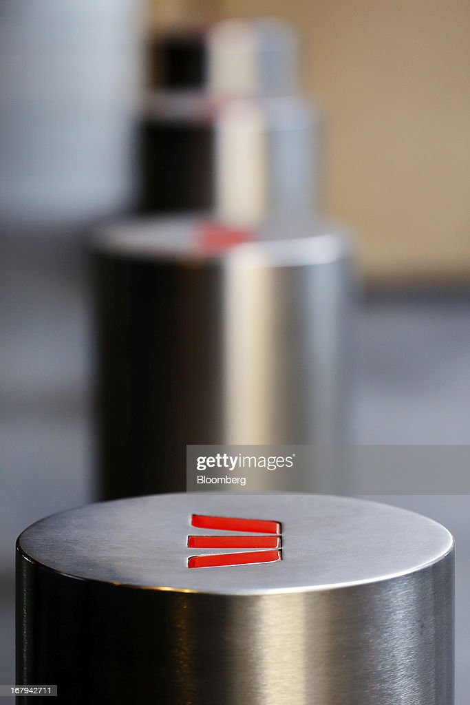 The Westpac Banking Corp. logo is displayed on bollards outside Westpac Place, the company's headquarters, in Sydney, Australia, on Friday, May 3, 2013. Westpac, Australia's second-biggest lender by market value, will pay a special dividend for the first time since 1988 after first-half cash earnings rose 10 percent on tighter cost controls. Photographer: Brendon Thorne/Bloomberg via Getty Images