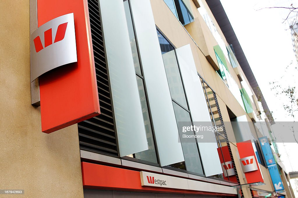 The Westpac Banking Corp. logo is displayed outside Westpac Place, the company's headquarters, in Sydney, Australia, on Friday, May 3, 2013. Westpac, Australia's second-biggest lender by market value, will pay a special dividend for the first time since 1988 after first-half cash earnings rose 10 percent on tighter cost controls. Photographer: Brendon Thorne/Bloomberg via Getty Images