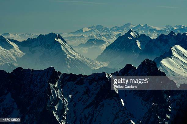 The Wetterstein mountains are seen during a partial solar eclipse on March 20 2015 in GarmischPartenkirchen Germany Over Central Europe the moon was...