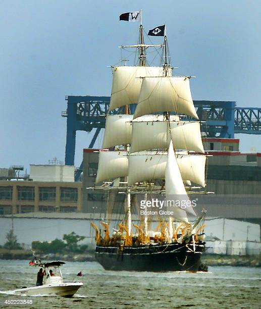 The whaling ship Charles W Morgan sailed into Boston Harbor where it docked next to the USS Constitution