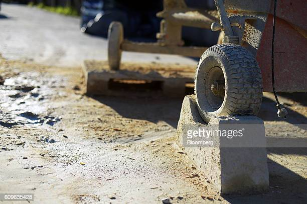 The wheel of a cement mixer sits on a concrete stand at the yard of Gully Concrete supplies in Melbourne Australia on Tuesday Aug 16 2016 Australia's...